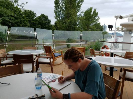 sketching on the boat