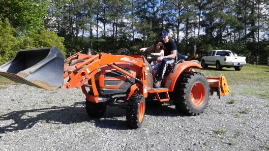 Talia on the tractor 4-25-17